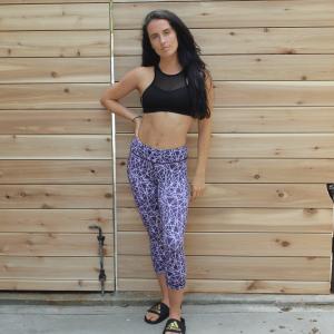 girl wearing prismatic capri leggings